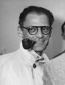 American Playwright Arthur Miller Smoking a Pipe